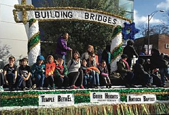 "The Martin Luther King Day Parade on Saturday, January 16, 2016 with the ""Building Bridges"" float sponsored by Antioch Missionary Baptist Church, Grier Heights Presbyterian Church, and Temple Beth El, Charlotte, NC."
